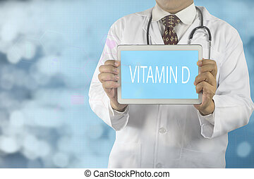Doctor holding a tablet pc with Vitamin D text on screen,...