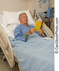 Get Well - Man in hospital bed reading a get well card