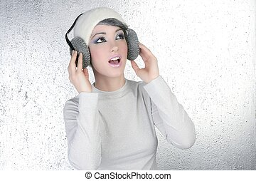 futuristic fashion woman hearing music headphones -...