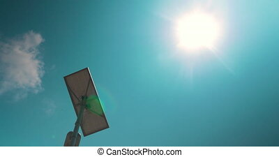 Street lamp with solar battery against the sky - Low angle...
