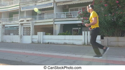Side view of man jogging in the morning - Young man in...