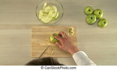Cutting apples for baking. - Cook cutting and cleaning...