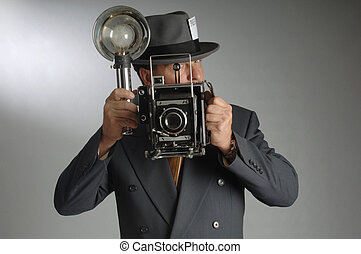 Photo Journalist - Retro photo journalist wearing a Fedora...