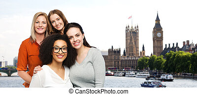 group of happy different women over london city -...