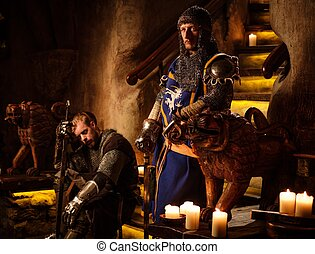 Medieval knights in ancient castle interior