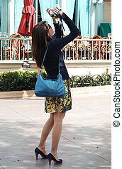 Summer Tourist - Young woman tourist taking pictures