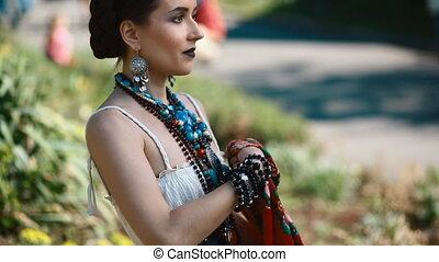 Young female model in mexican dress posing outdoor