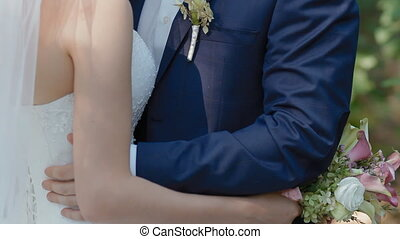 Bride and groom pose outdoor with natural light Young man...