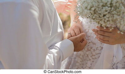 Man and woman embrace each other - Bride and groom embrace...