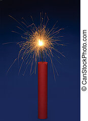 Dynamite - Stick of dynamite with a lit fuse on a blue...