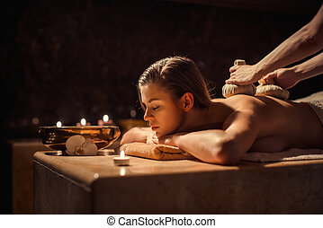 Massage - Woman with herbal compress massage in beauty spa