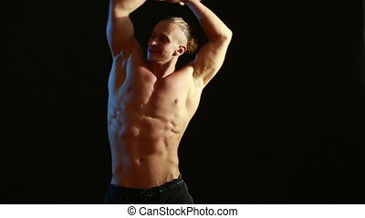 Muscular man bodybuilder Man posing on a black background,...
