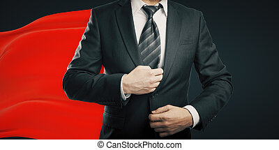 Red cape dark background - Businessman with red superhero...