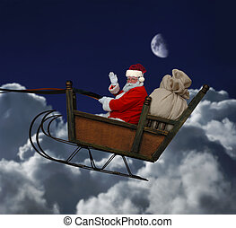 Santa in Flight - Santa in his sleigh flying throught a...