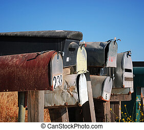 Grungy mailboxes - A row of grungy mailboxes in the country