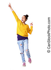 Excited young woman standing with her arms up - Full length...