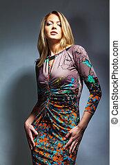 pretty fashionable girl - studio portrait of young pretty...