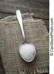 Coarse salt in a large old spoon, close up