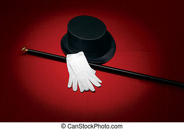 Entertainer - Top hat, white gloves and black cane on red...