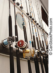 fishing poles on a boat - Deep Sea fishing poles lined up on...