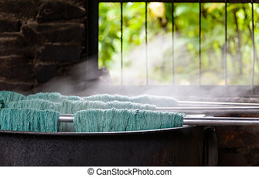 Traditional wool dying - Natural wool dyeing in a carpet...