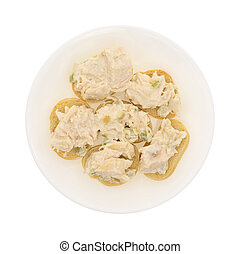 Chicken salad on a small pieces of French bread