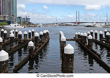 Wooden poles at the Melbourne Docklands in Victoria Harbour,...