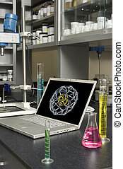 Laboratory Laptop - Laptop in a chemical laboratory amidst...