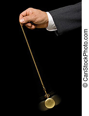hypnosis - Man\'s hand holding a pocket watch and swinging...