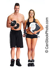 Fitness couple with dumbbell and scales.