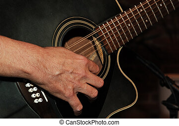 guitar solo - closeup of guitarist\'s hands strumming a...