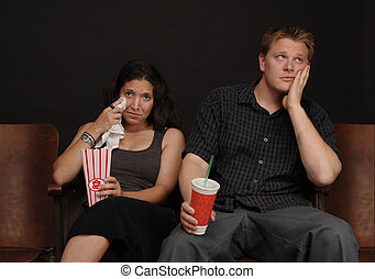 Chick Flick - Couple on a date at the movies with a bored...