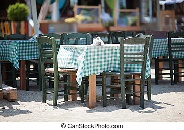 Empty Tables and Chairs on Sunny Restaurant Patio