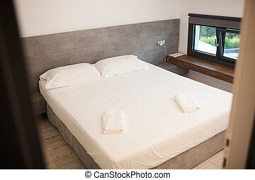 Empty hotel room for two with matrimonial bed - Empty clean...