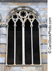 Gothic window with traceries on Monumental cemetery...