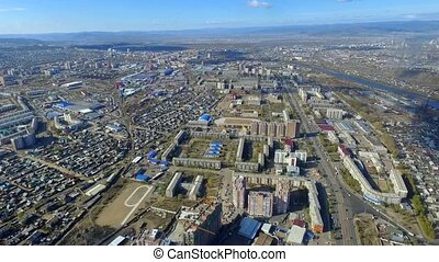 An aerial view of autumn streets of the city of Ulan-Ude,...