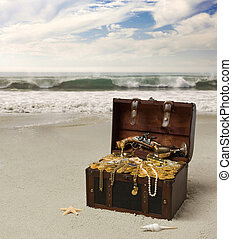 pirates treasure - An open treasure chest on the beach