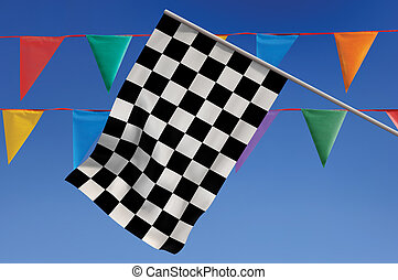 Race Day - Checkered flag against a blue sky with colorful...