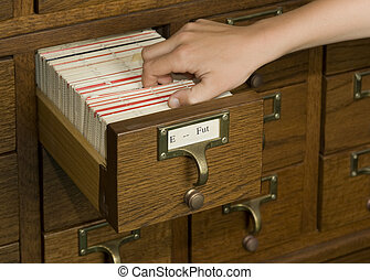 Library Research - Hand reaching into a card catalog file...