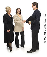 Professional Group - Two woman and one man dressed in...