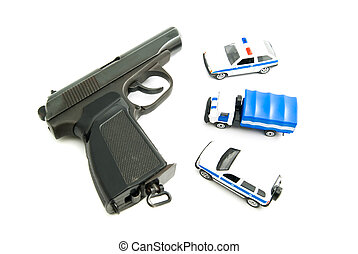 Gun and police cars on white background closeup