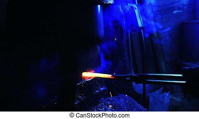Blacksmith Forging a Knife
