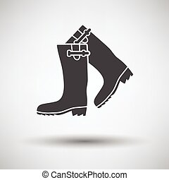 Hunter's rubber boots icon on gray background with round...