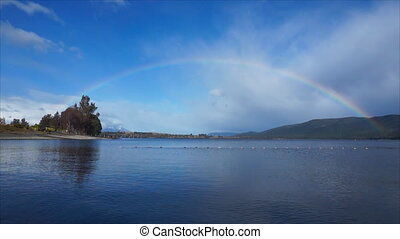 Rainbow over lake Te Anau, New Zealand - Rainbow over water....