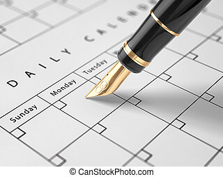 Planning - A luxery fountain pen wrighting in a calendar