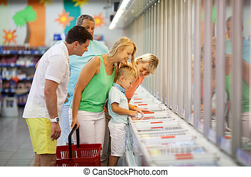 Young family shopping with the Grandparents in a supermarket...