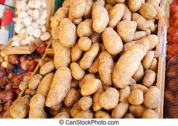 Brown Skin Potatoes Piled in Crates at Food Market