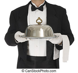 Food and Beverage - Waiter torso holding a silver tray with...