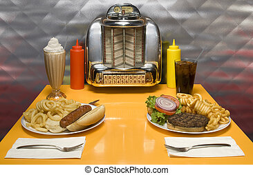 Retro Diner - 1950\'s style diner table with juke box, malt,...