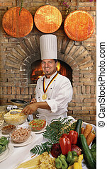 Gourmet Chef - Gourmet chef preparing food in front of a...